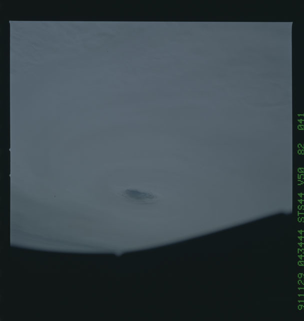S44-82-041 - STS-044 - Earth limb view of super typhoon Yuri taken during the STS-44 mission