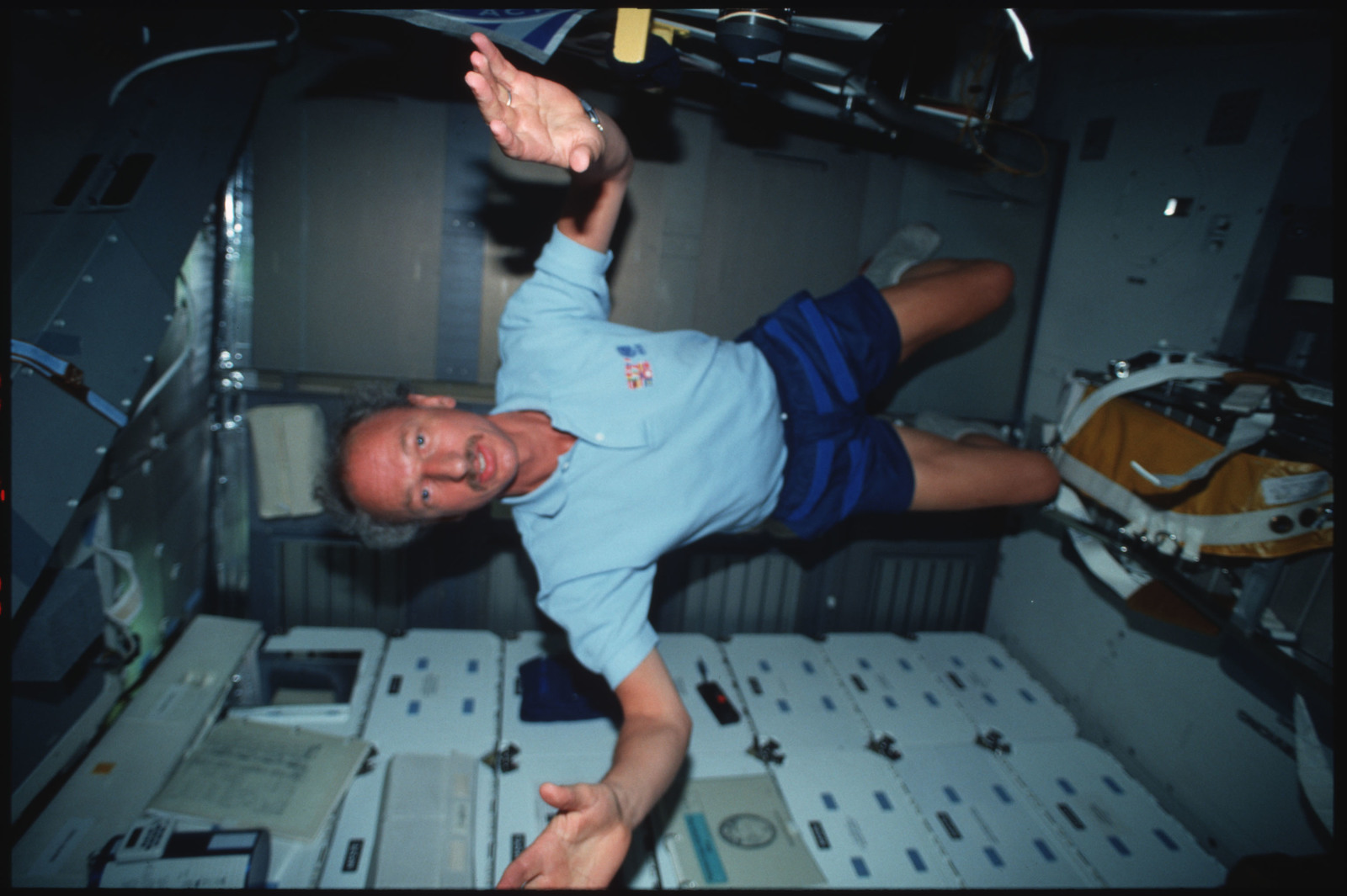 S45-07-032 - STS-045 - STS-45 crewmembers on the middeck of Atlantis