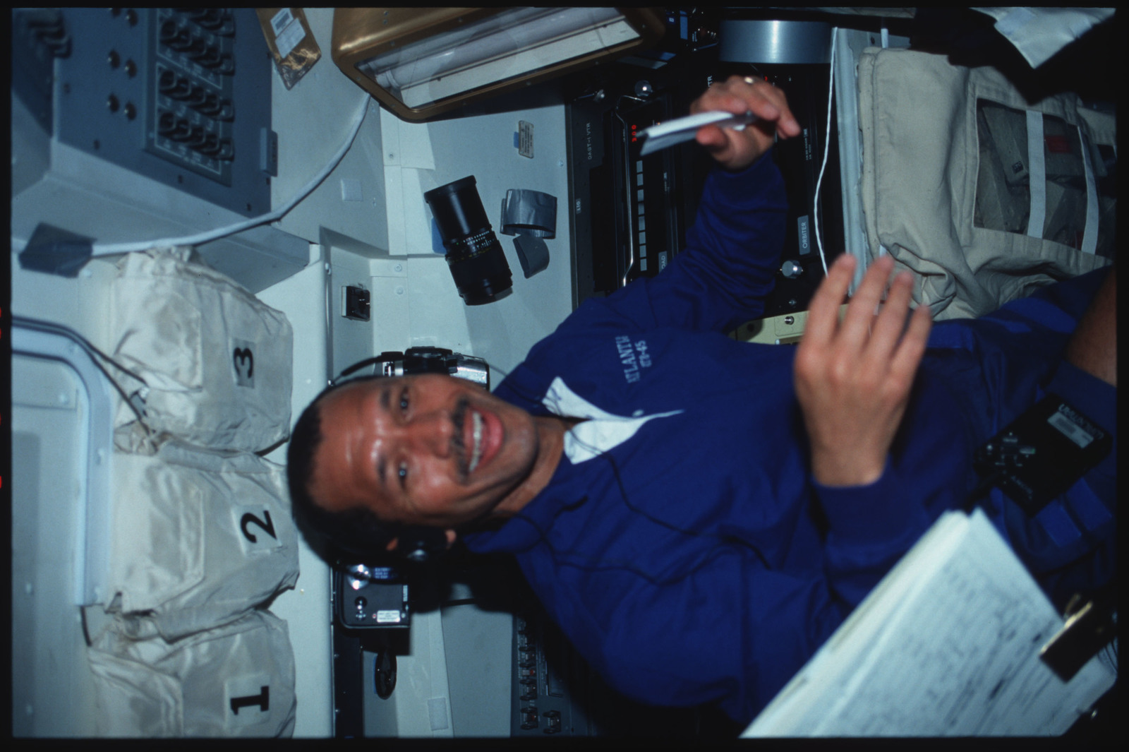 S45-13-036 - STS-045 - STS-45 crewmembers engage in various activities