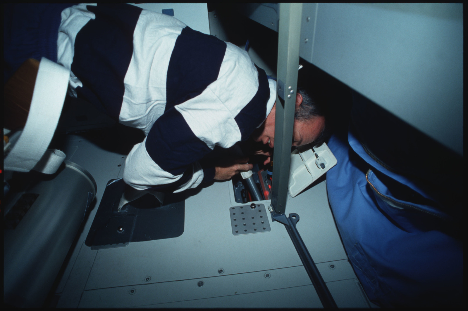 S45-14-017 - STS-045 - STS-45 crewmembers engaged in orbiter maintenance