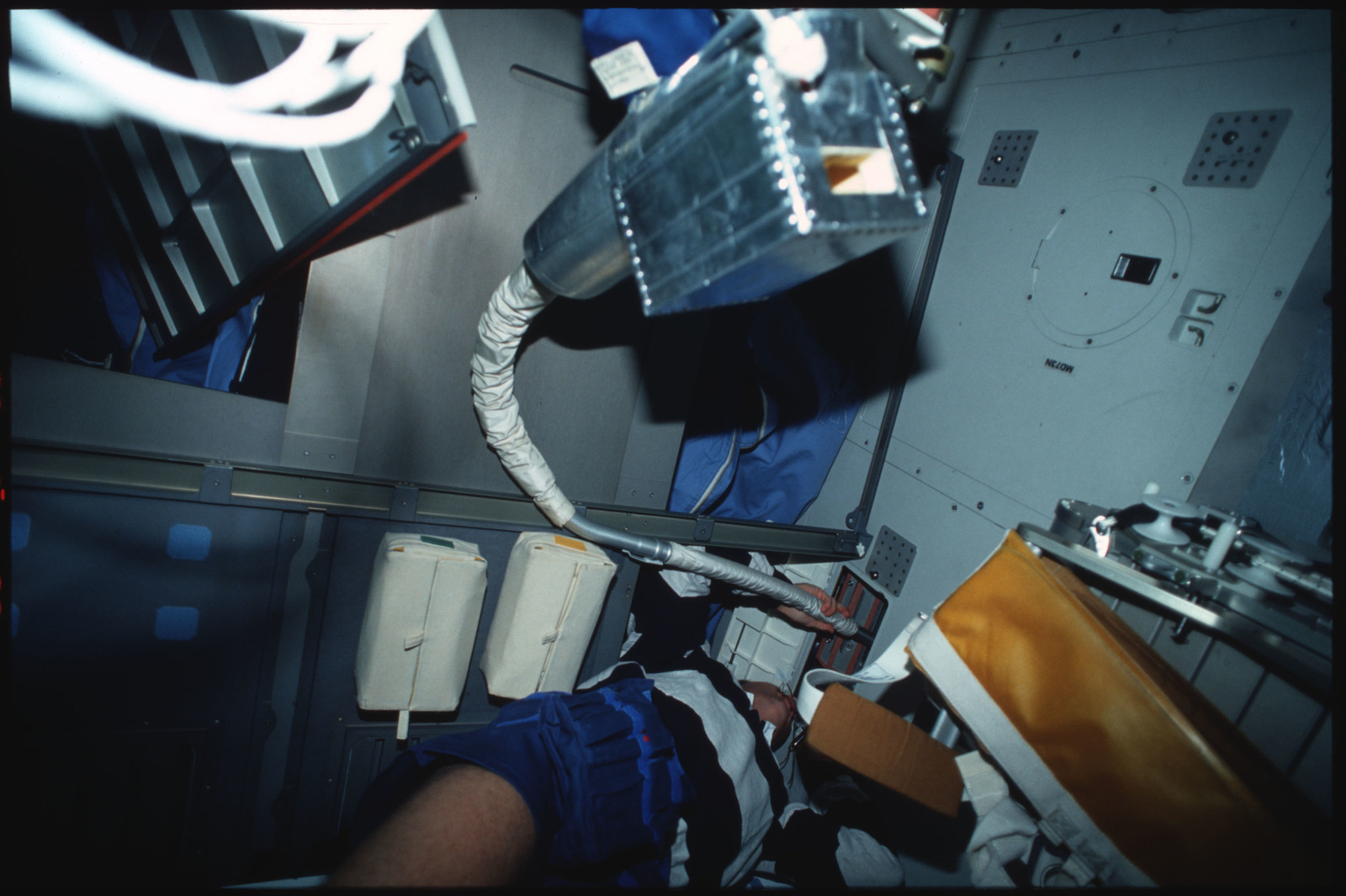 S45-14-019 - STS-045 - STS-45 crewmembers engaged in orbiter maintenance