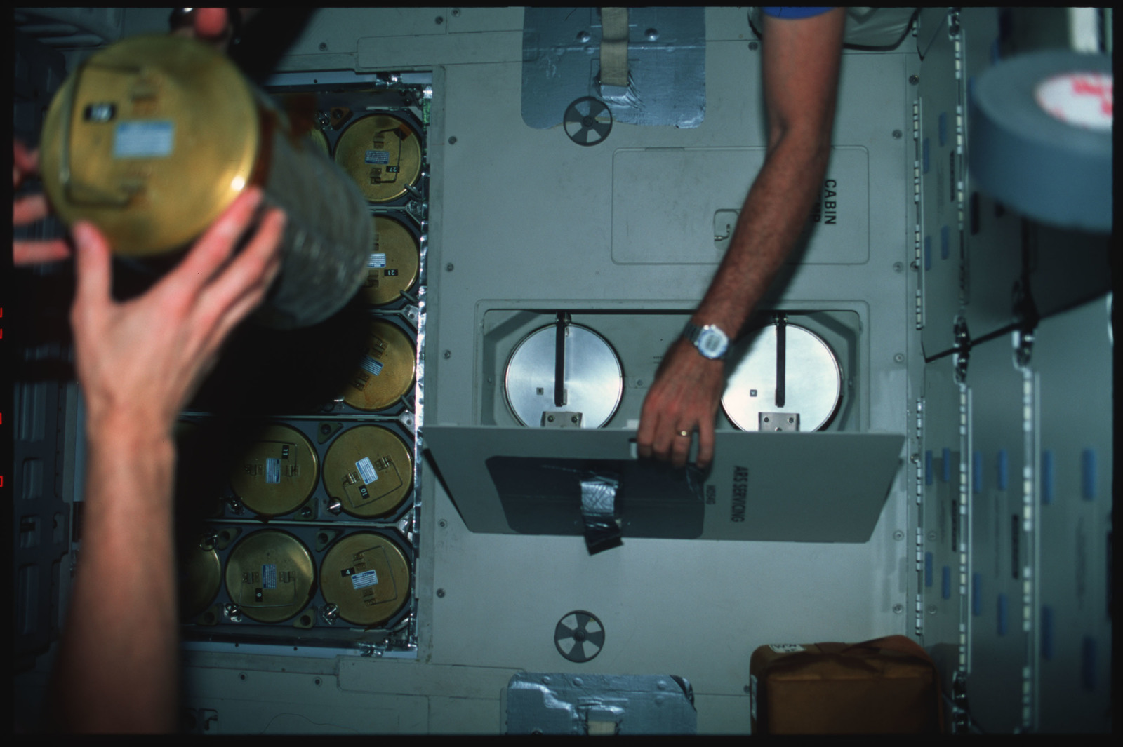 S45-41-018 - STS-045 - STS-45 crewmembers switch out LiOH canisters