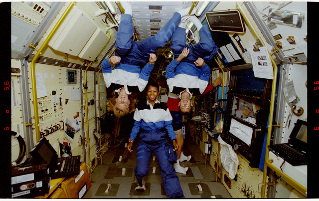 S47-12-012 - STS-047 - Portrait of three mission specialists on STS-47