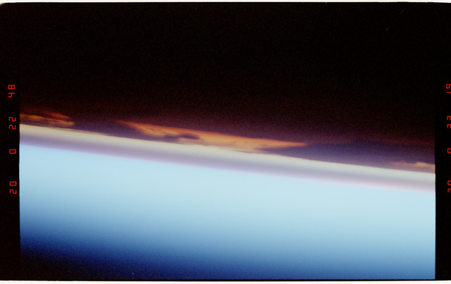 S47-213-024 - STS-047 - Illuminated earth limb seen through window of Endeavour during STS-47
