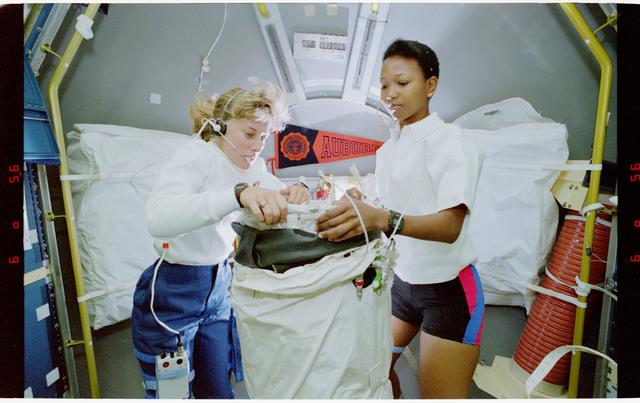 S47-46-027 - STS-047 - LBNP:  MS Davis and MS Jemison prepare LBNP device