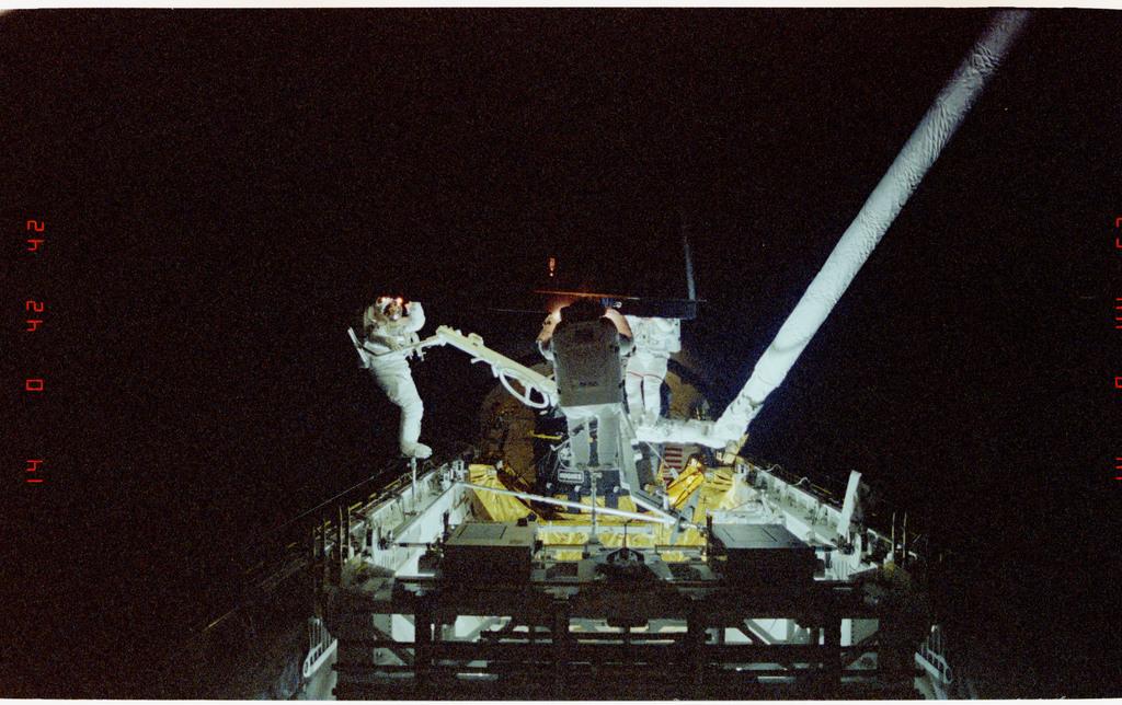 S49-211-002 - STS-049 - Three Mission Specialist EVA manual INTELSAT capture.