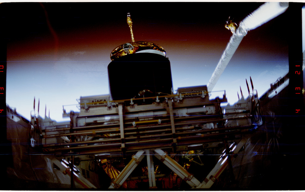 S49-217-029 - STS-049 - Sunrise, stowed ASEM and the repaired INTELSAT ready for redeploy.