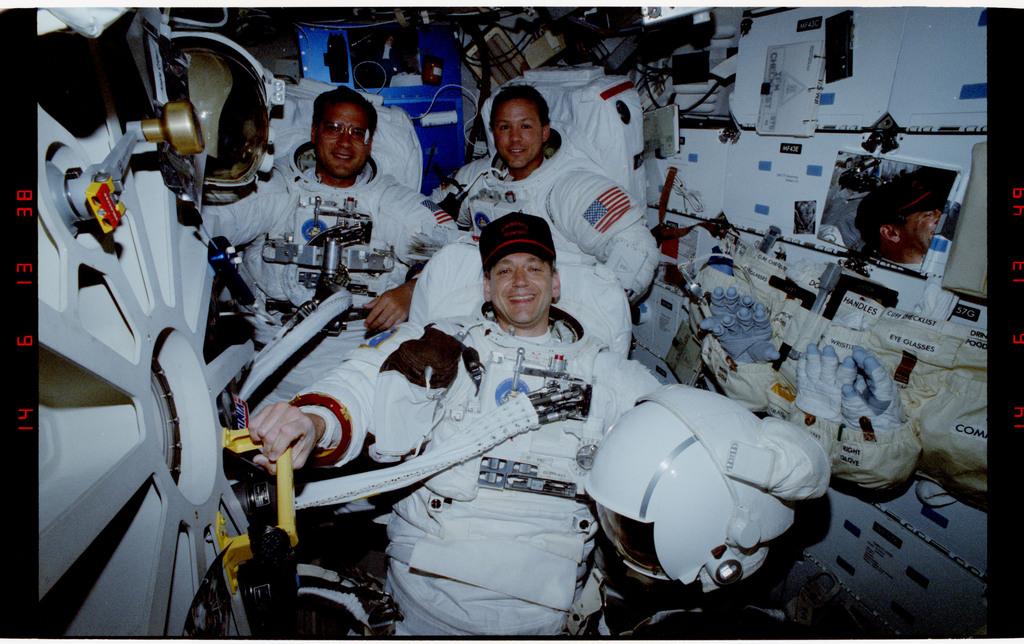 S49-26-007 - STS-049 - Post EVA views of the three crewmembers who retrieved the INTELSAT satellite.