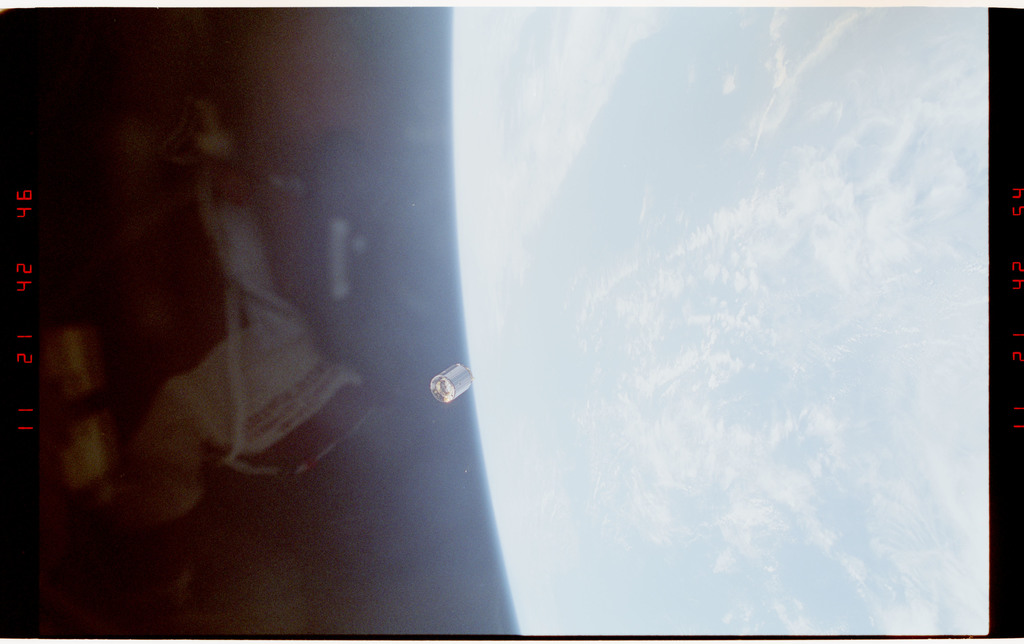 S49-37-022 - STS-049 - A pre capture sequence of views of the INTELSAT floating freely in space.