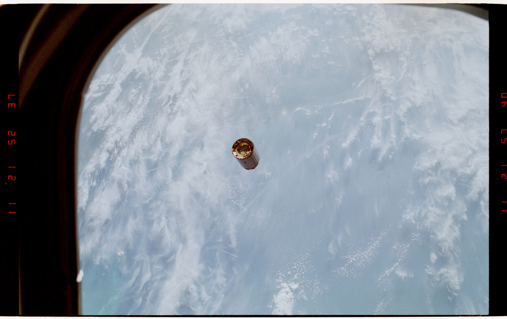 S49-37-025 - STS-049 - A pre capture sequence of views of the INTELSAT floating freely in space.