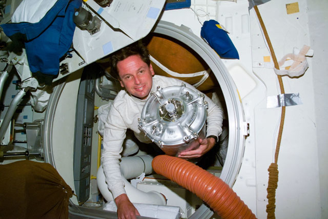 S71E0075 - STS-071 - Mission specialist Harbaugh on Atlantis with Mir water container