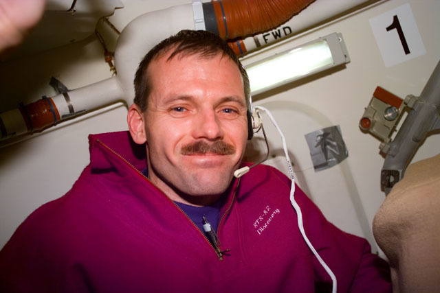 S82E5064 - STS-082 - Mission Specialist Steven L. Smith smiles for the camera in the airlock