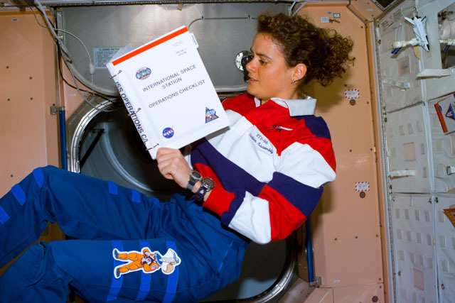S96E5178 - STS-096 - MS Payette reads ISS Operations Checklist in the Node 1/Unity module