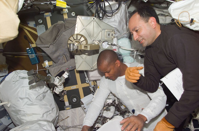 S98E5104 - STS-098 - PLT Polansky and MS Curbeam on middeck preparing for EVA