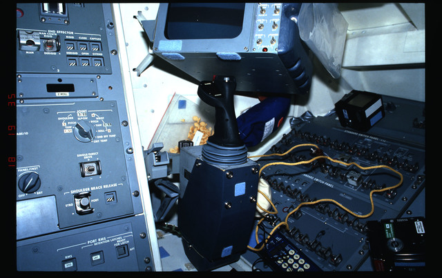 STS031-11-001 - STS-031 - Documentation showing aft control station on the flight deck