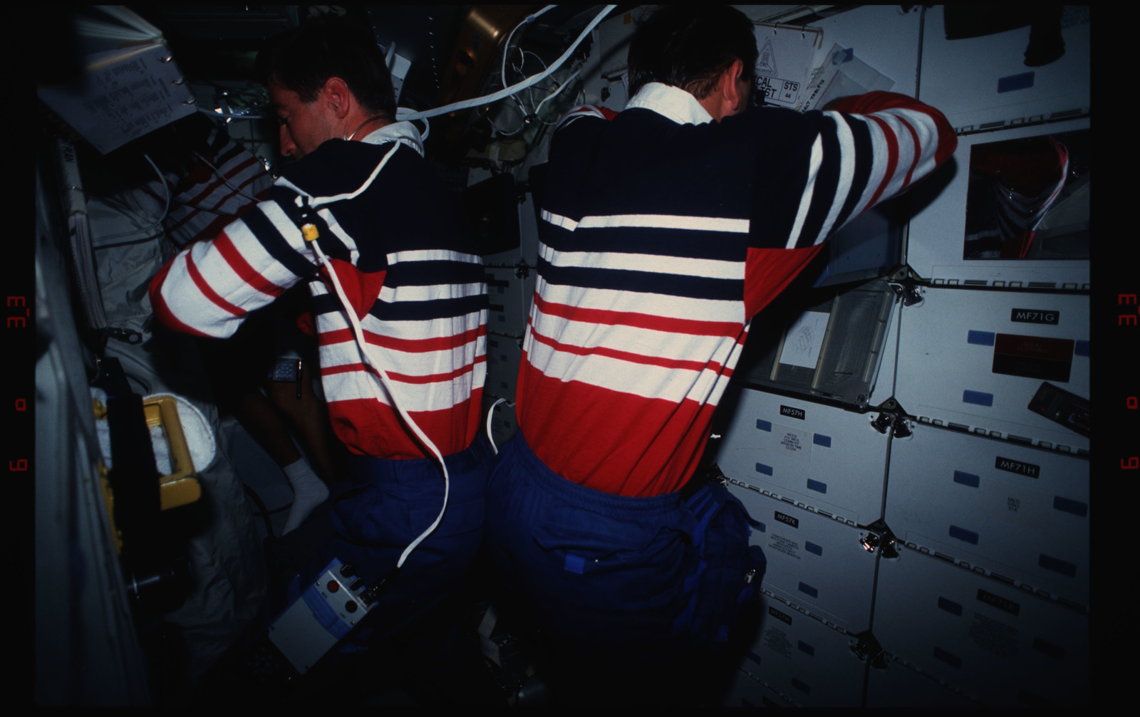 STS044-16-032 - STS-044 - STS-44 Pilot Henricks and PS Hennen work on OV-104's middeck