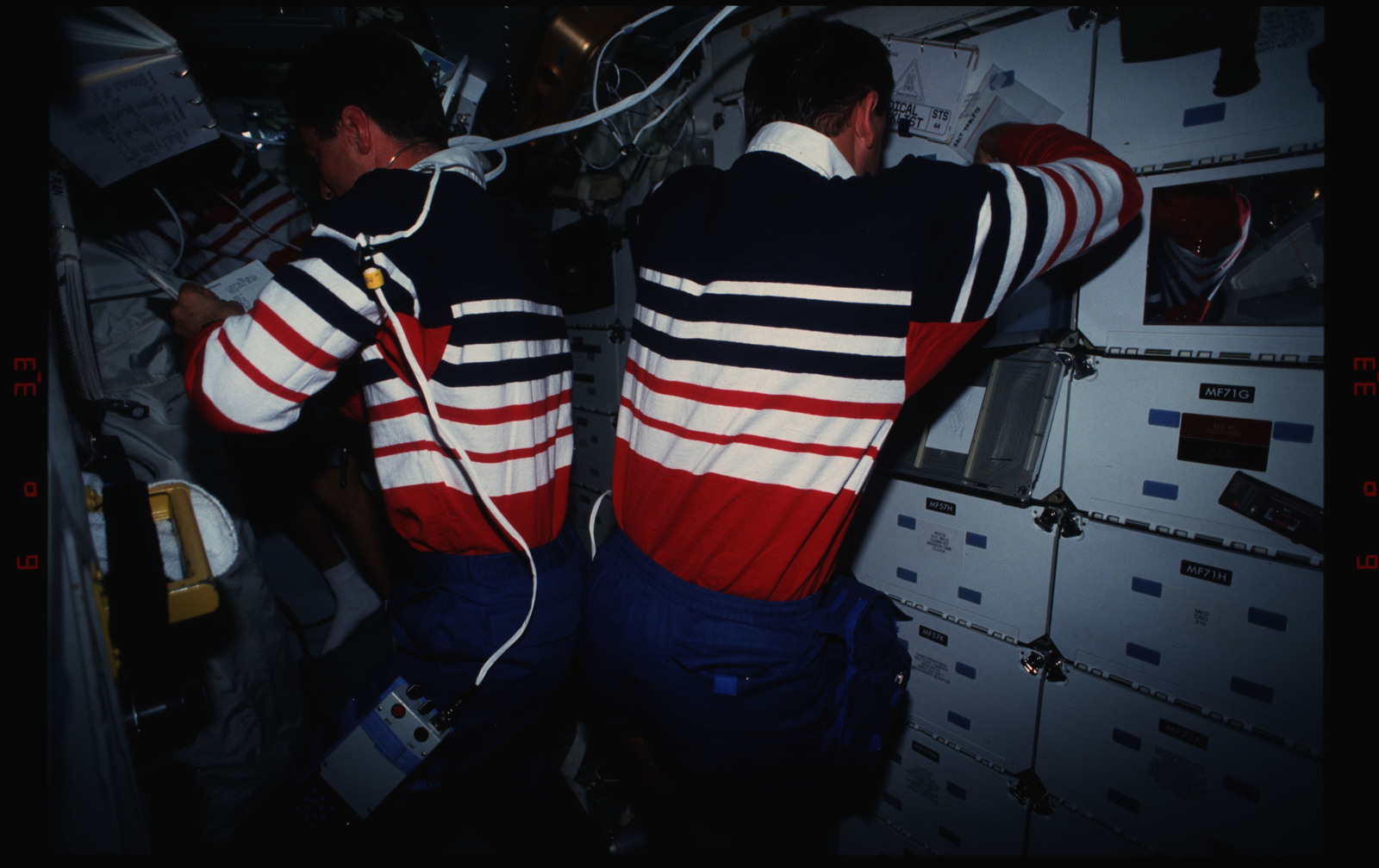 STS044-16-033 - STS-044 - STS-44 Pilot Henricks and PS Hennen work on OV-104's middeck