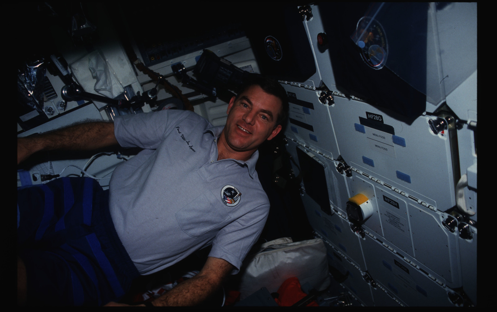 STS044-19-009 - STS-044 - STS-44 Voss poses for a photo with a VITT polo shirt on OV-104's middeck