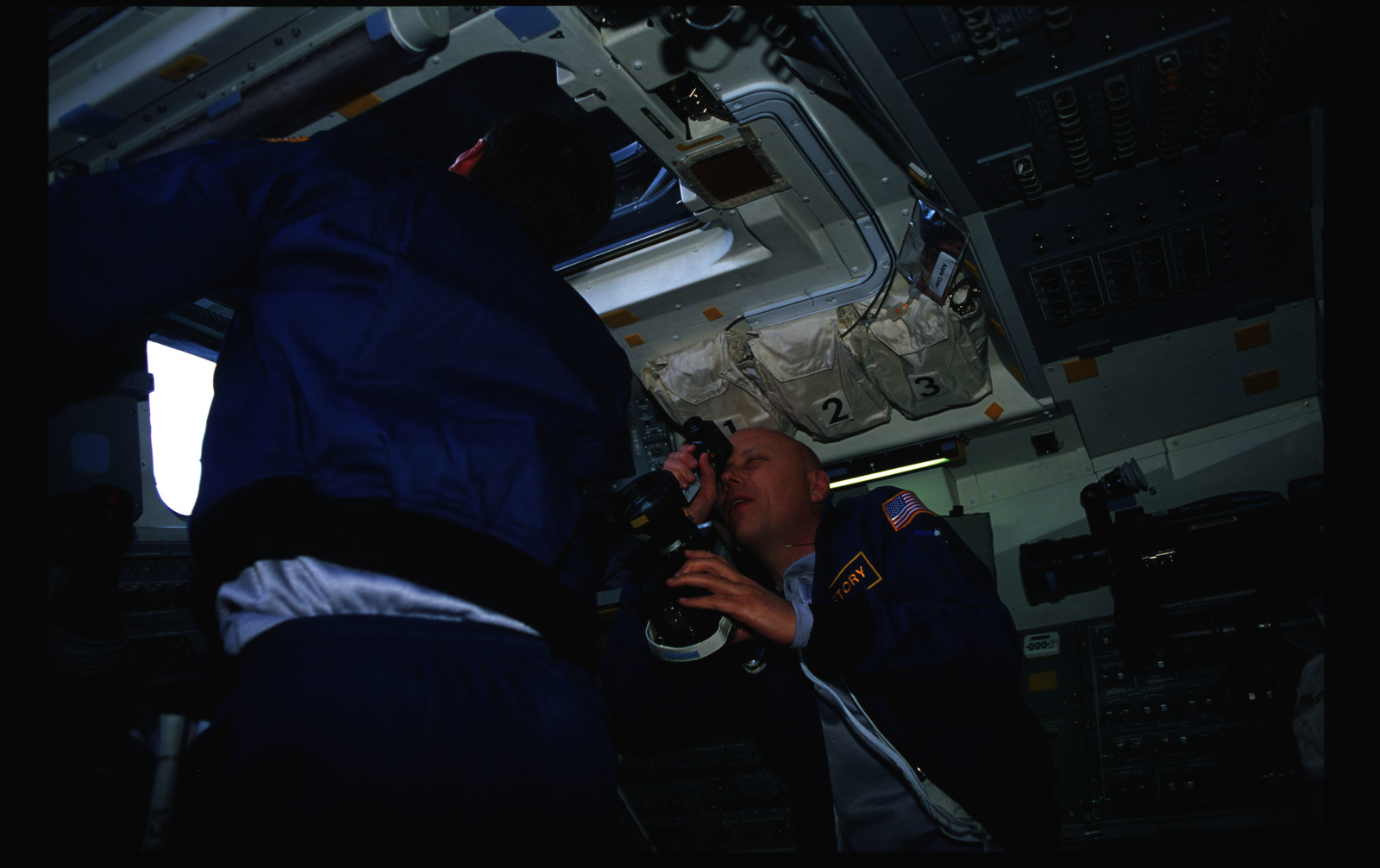 STS044-36-014 - STS-044 - STS-44 Musgrave and Henricks work on OV-104's aft flight deck