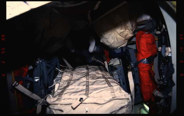 STS050-03-004 - STS-050 - Legs and feet of an unidentified male crewmember transiting the airlock.