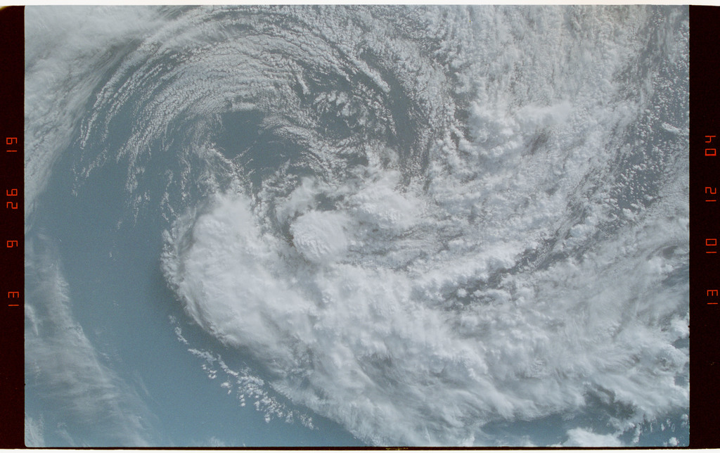 STS050-239-026 - STS-050 - Clouds, clockwise spiral gyre over open ocean.  Location unknown.