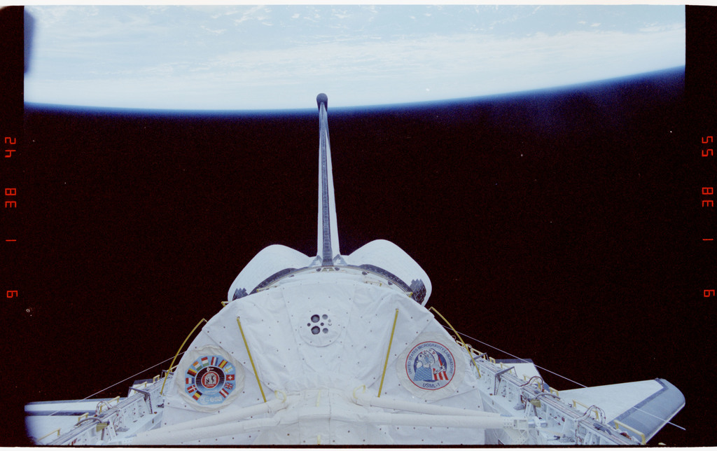 STS050-27-036 - STS-050 - Orbiter tail, payload bay, spacelab and earth limb.