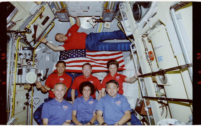 STS050-291-004 - STS-050 - In orbit crew portrait of all crewmembers in the spacelab.