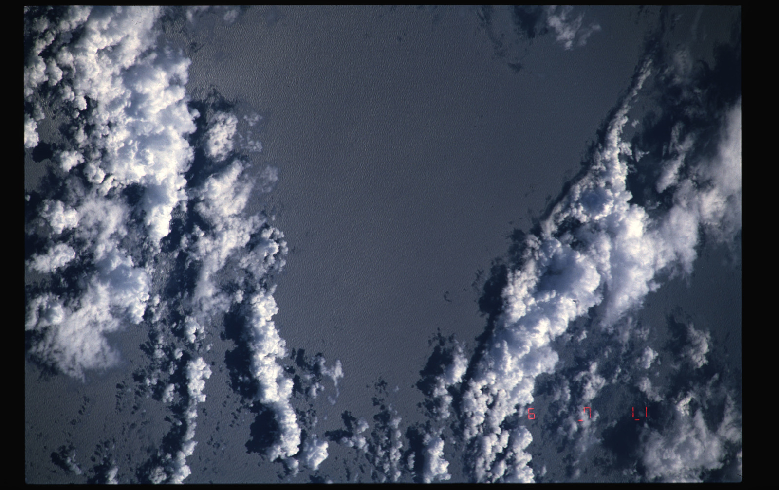 STS050-48-024 - STS-050 - Earth observation views of open ocean and clouds - location unknown.