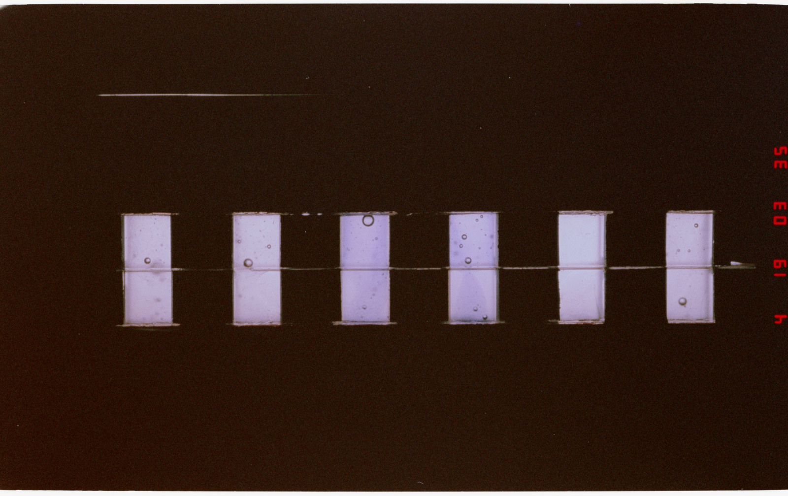 STS052-209-029 - STS-052 - Protein crystal growth sample trays from the middeck CMIX experiment module.