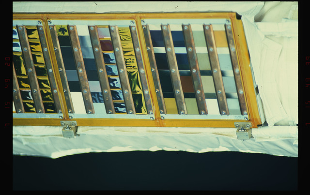 STS052-38-033 - STS-052 - Witness plate material sample trays on the Remote Manipulator System.