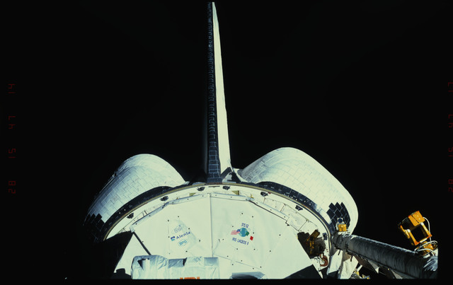 STS052-41-009 - STS-052 - Views of the payload bay showing the Canadian LAGEOS II and other logos.