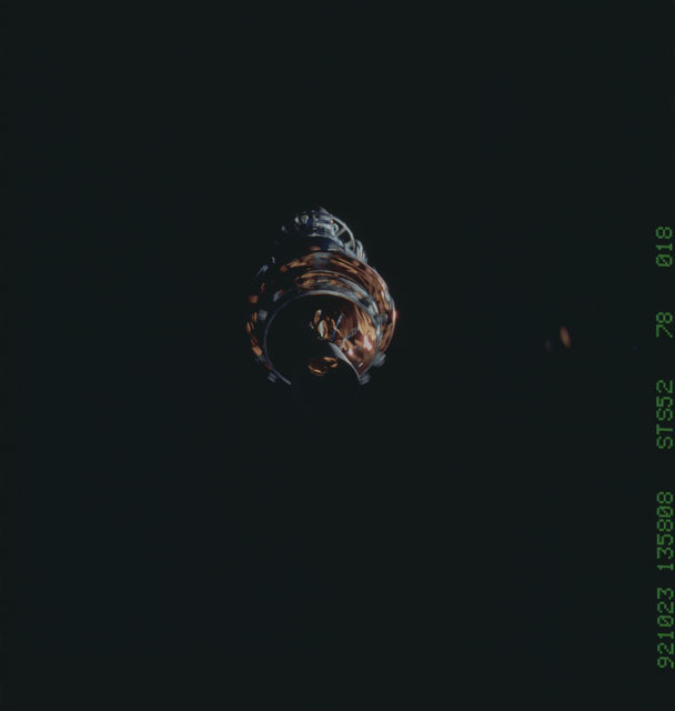 STS052-78-018 - STS-052 - The deployed LAGEOS II/IRIS spacecraft drifting in space during STS-52