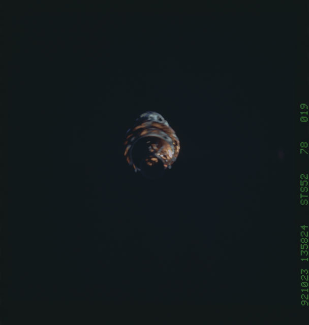 STS052-78-019 - STS-052 - The deployed LAGEOS II/IRIS spacecraft drifting in space during STS-52