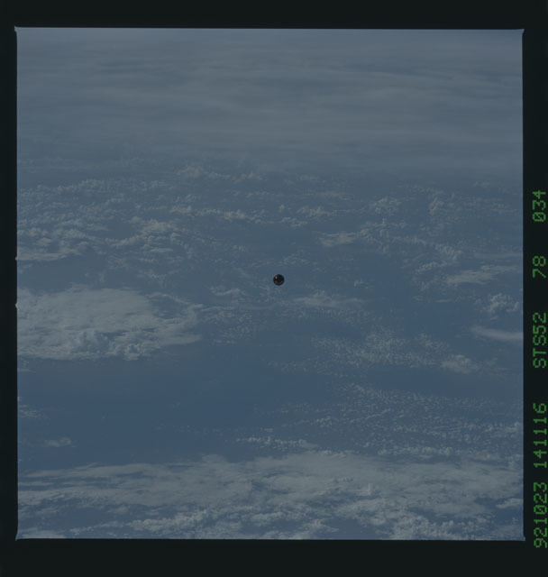 STS052-78-034 - STS-052 - The deployed LAGEOS II spacecraft drifting above the Earth during STS-52