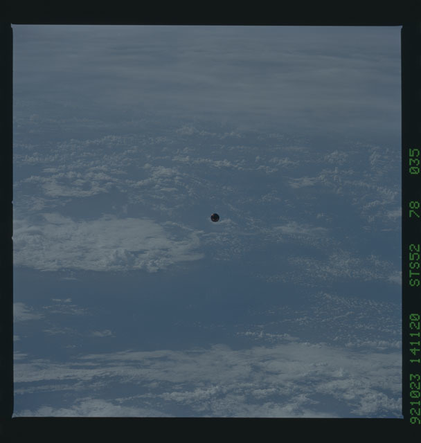 STS052-78-035 - STS-052 - The deployed LAGEOS II spacecraft drifting above the Earth during STS-52