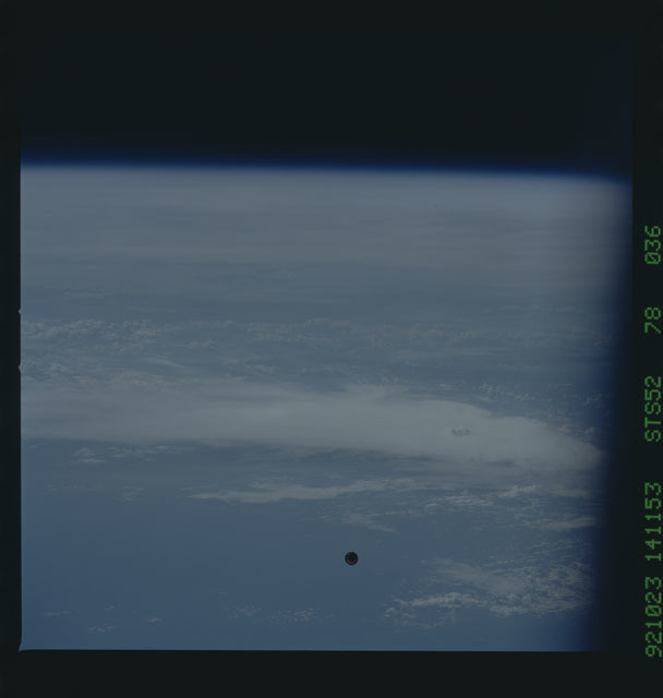 STS052-78-036 - STS-052 - The deployed LAGEOS II spacecraft drifting above the Earth during STS-52