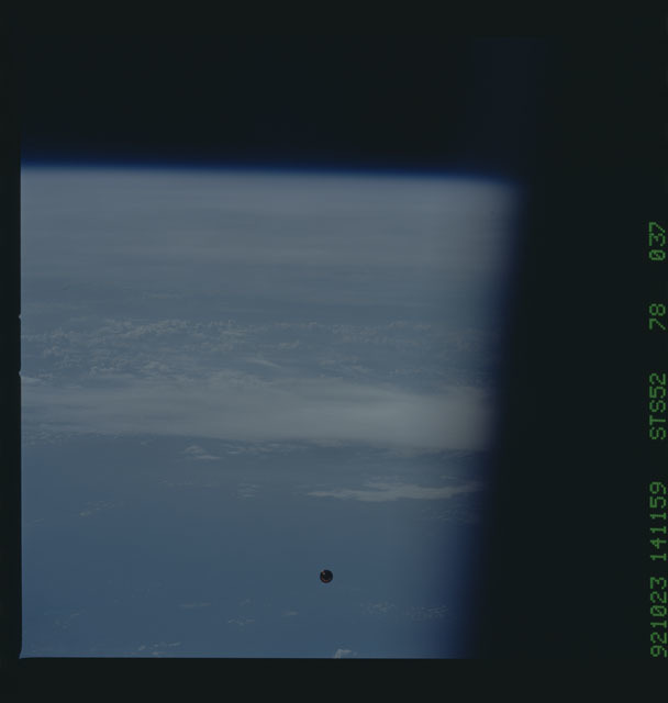STS052-78-037 - STS-052 - The deployed LAGEOS II spacecraft drifting above the Earth during STS-52