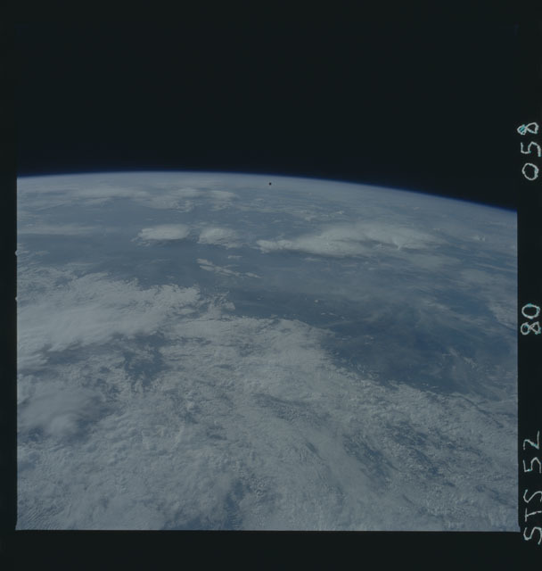 STS052-80-058 - STS-052 - STS-52 LAGEOS/IRIS spacecraft drifting over the Earth