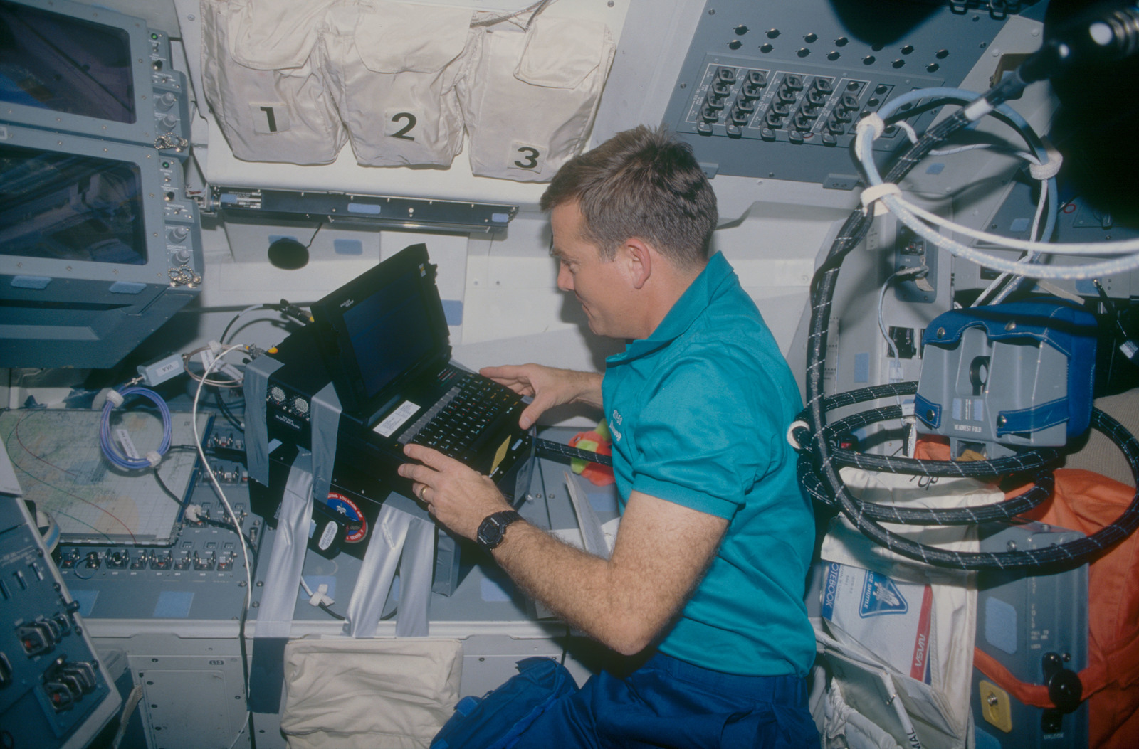 STS053-05-018 - STS-053 - Crewmember in the aft FD with laptop terminal