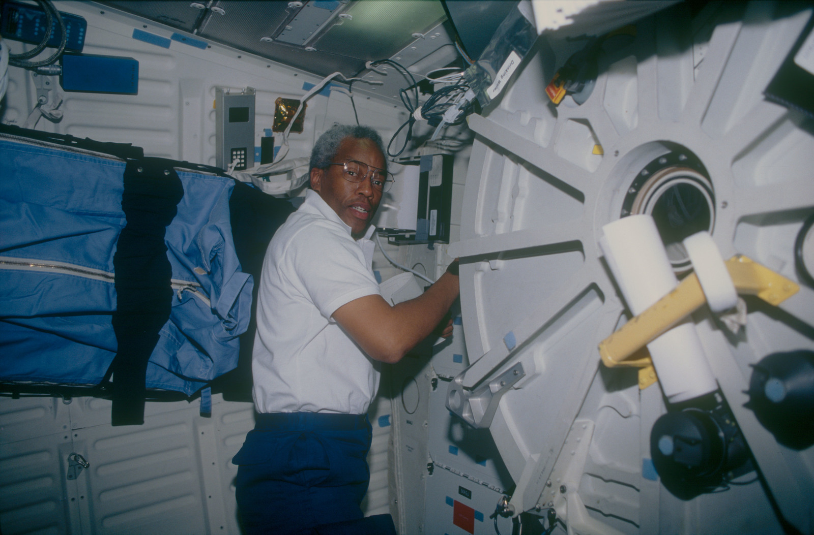 STS053-06-002 - STS-053 - Crewmember in the MDDK at the aft stowage lockers by the air lock