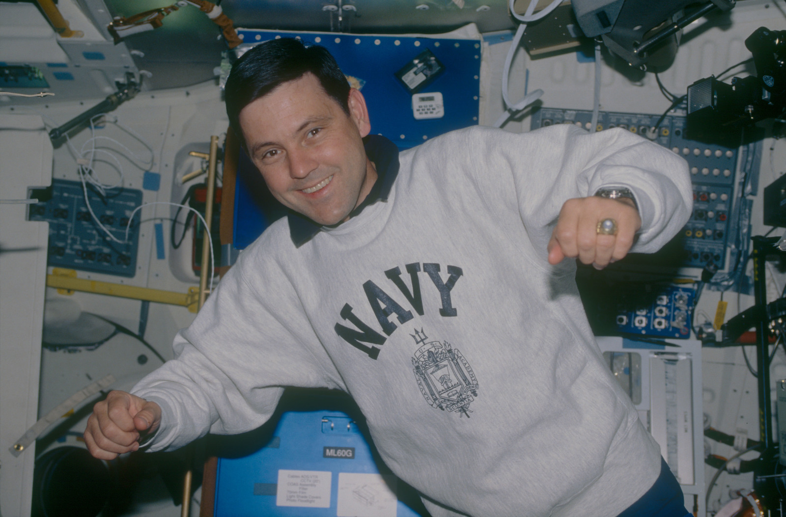 STS053-07-005 - STS-053 - Crewmember in the MDDK wearing a U. S. Navy sweat shirt