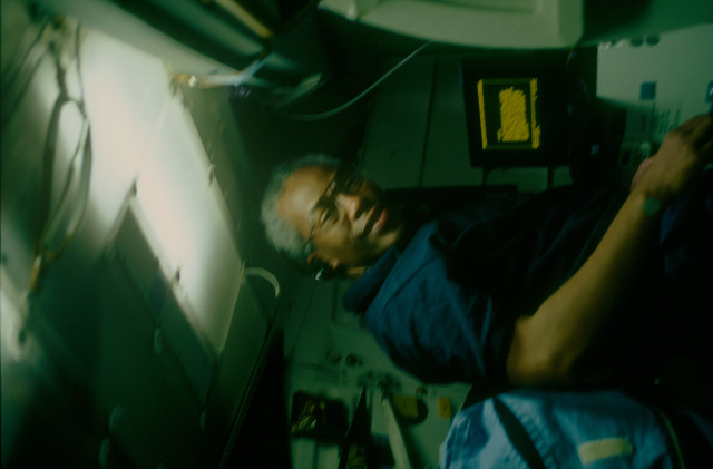 STS053-08-009 - STS-053 - Crewmember with the laptop terminal in the MDDK at aft stowage lockers.