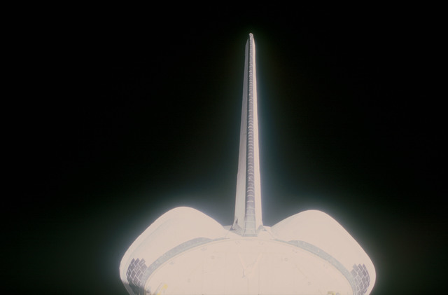 STS053-08-020 - STS-053 - Orbiter tail and rocket pods during the GLOW experiment