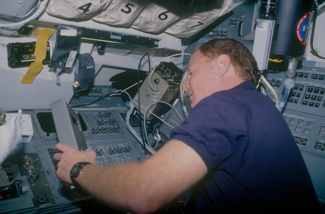 STS053-11-016 - STS-053 - Crewmember in the aft FD with Radiation Monitoring Equipment III
