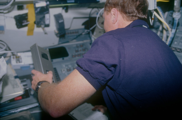 STS053-11-017 - STS-053 - Crewmember in the aft FD with Radiation Monitoring Equipment III