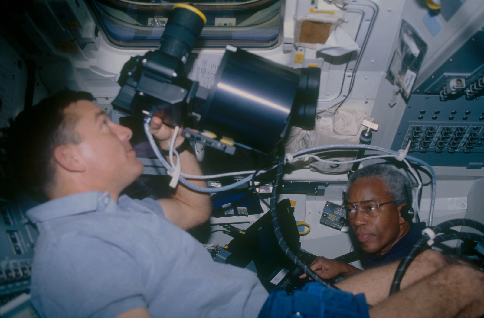 STS053-11-036 - STS-053 - Crewmembers with the HERCULES photographic system