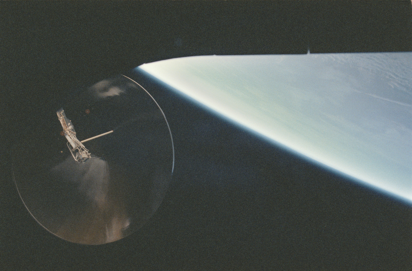 STS053-16-031 - STS-053 - KU antenna with possible auroral activity reflections in the antenna dish