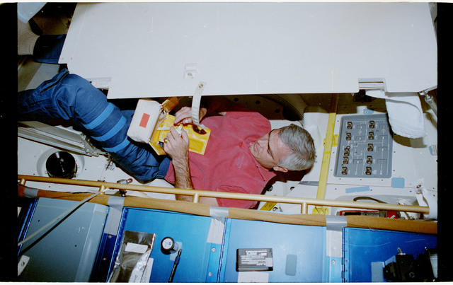 STS053-20-007 - STS-053 - Crewmember in the MDDK with personal hygiene kit