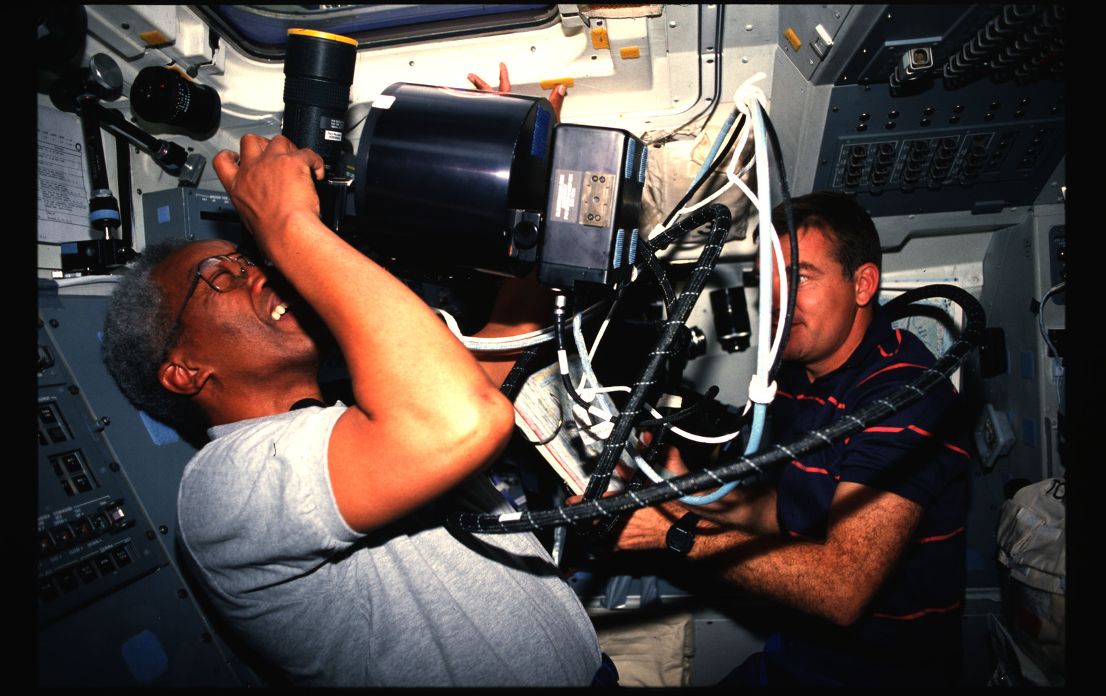 STS053-239-009 - STS-053 - Crewmembers using the HERCULES photographic system