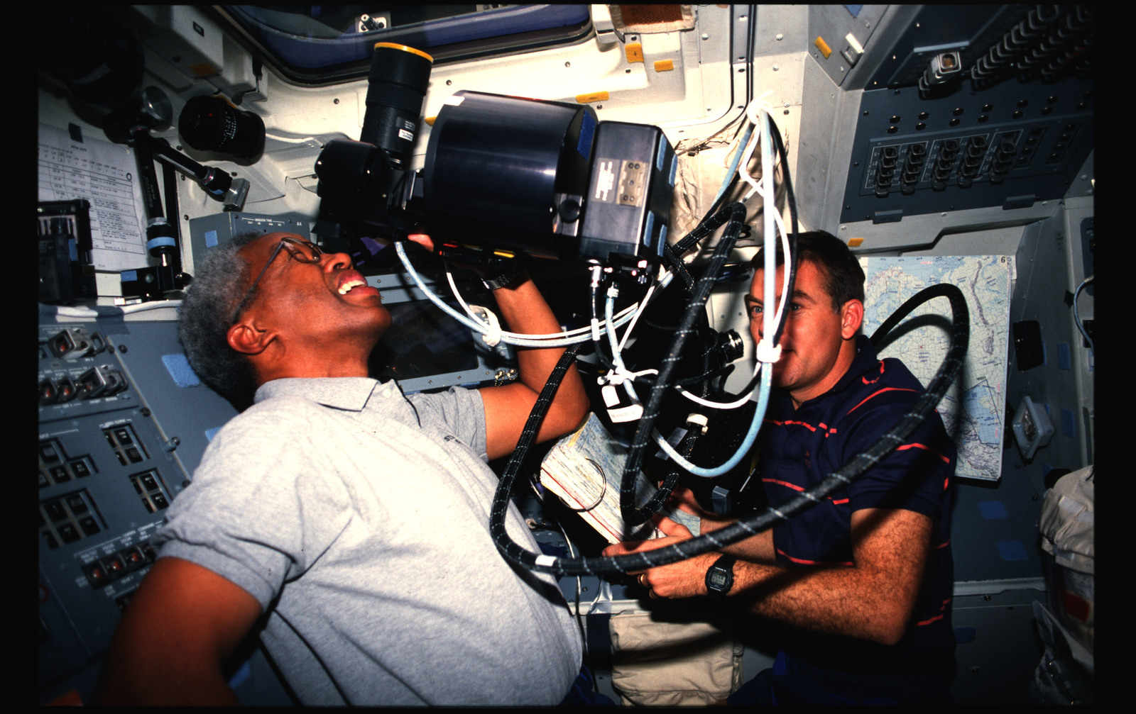 STS053-239-011 - STS-053 - Crewmembers using the HERCULES photographic system